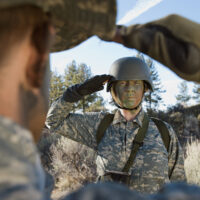 Female,Solider,Saluting,Troop,During,Training,Session